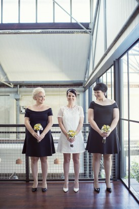 Bride with bridesmaids in sixties style dresses