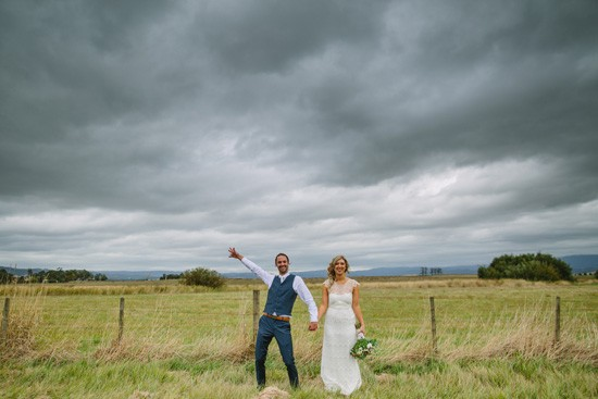 Country wedding photo with stormy sky