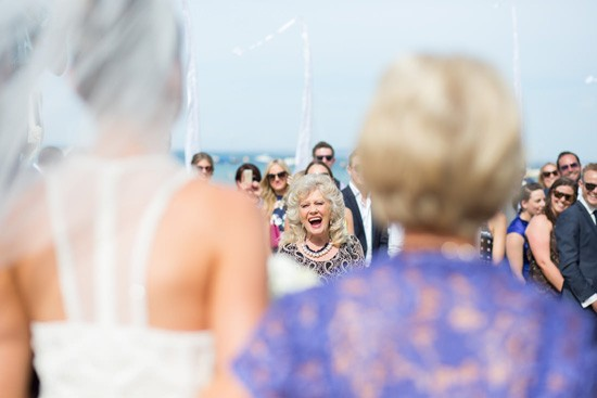 Expression of guests at bride walks down the aisle
