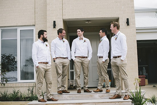 Groom and groomsmen in white shirts with khaki pants