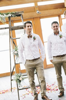 Groom in taupe pants and taupe bow tie