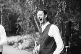 Groom laughing photo