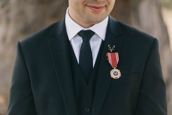 Groom with black suit and war medals