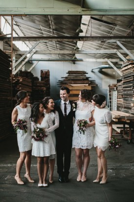 Groom with bridesmaids in white dresses