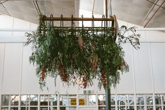 Hanging greenery centrepiece at wedding