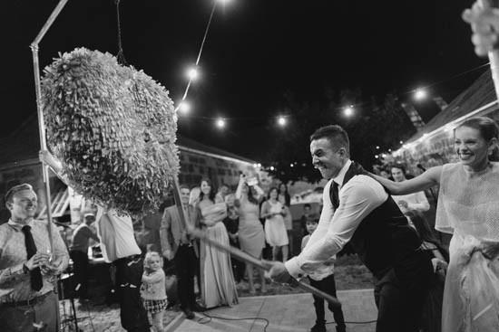 Hitting pinata at wedding