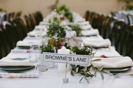 Long tables with table names at wedding