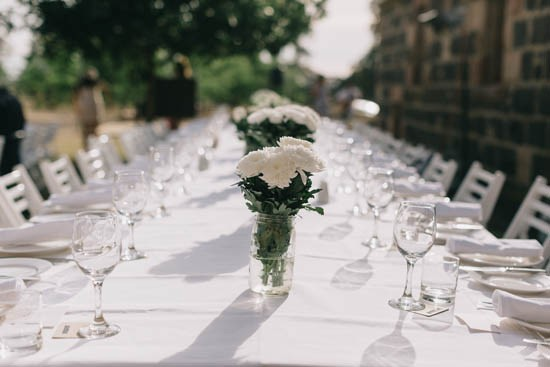 Long tables with white flowers at wedding reception