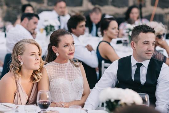 Newlyweds during wedding speeches