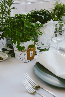 Potted herb place settings at wedding
