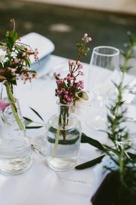 Wedding centrepieces with small bottles