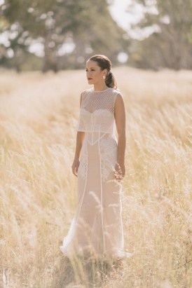 Wedding gown with mesh overlay