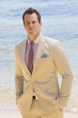 Groom in cream suit