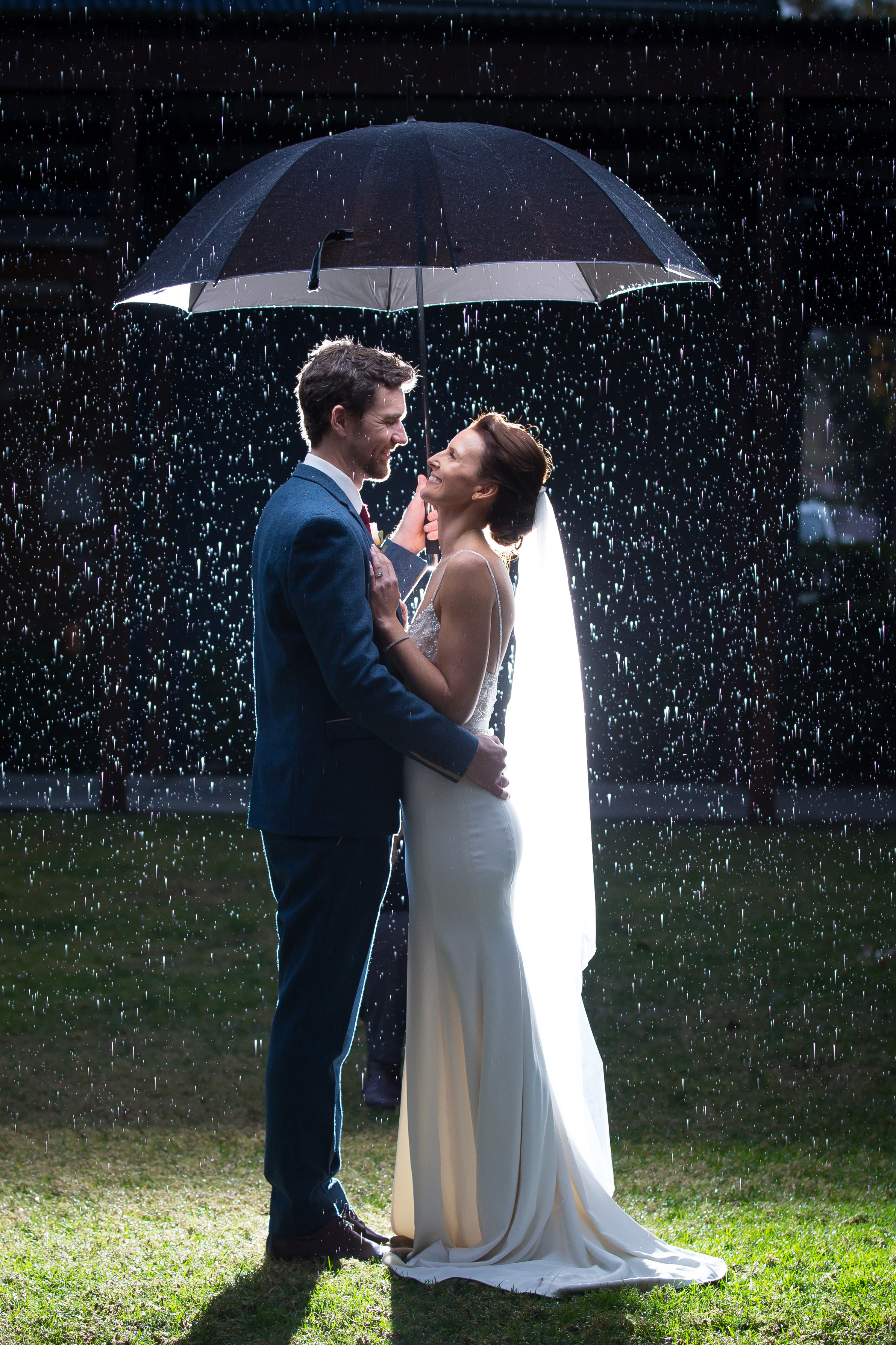 Rain became a constant companion through our wedding journey! (photo courtesy of Waterfield Photography)