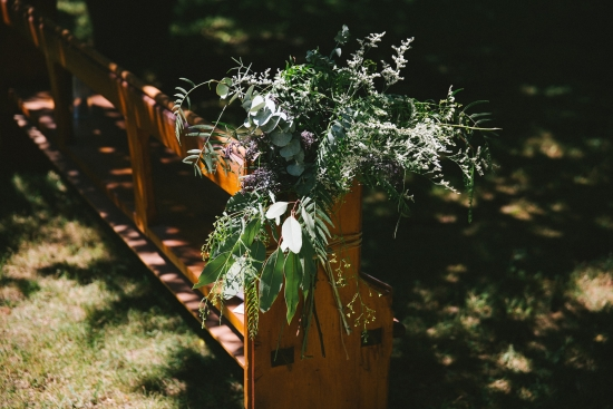greenery-on-pew-end-at-wedding