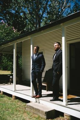 groom-with-groomsmen-in-navy-suits