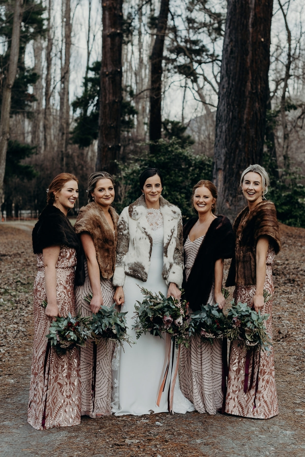 Bride and bridesmaids with winter wraps