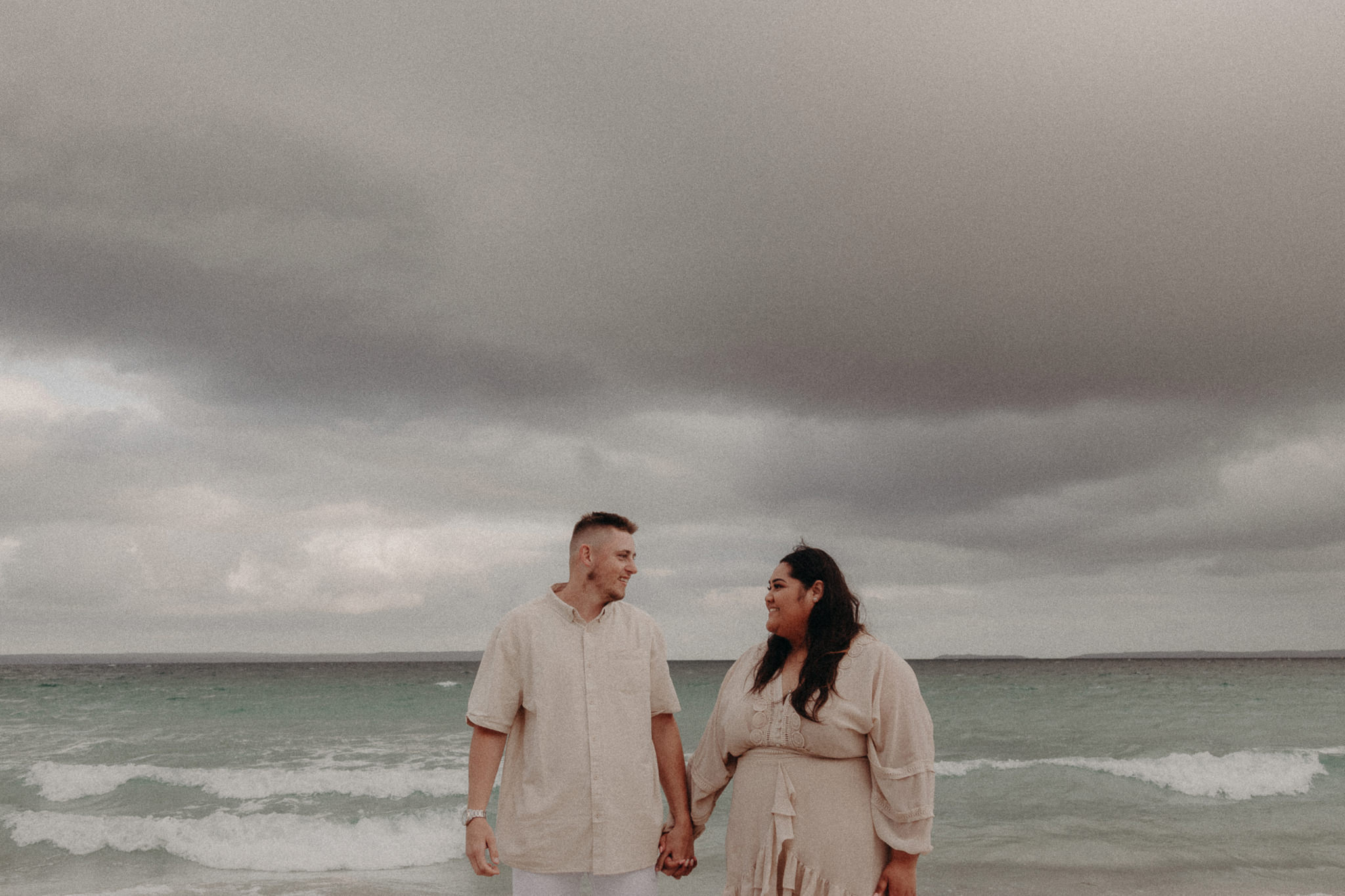 Windswept & Stormy Beachside Engagement Session + With A Surprise Proposal! - Polka Dot Wedding